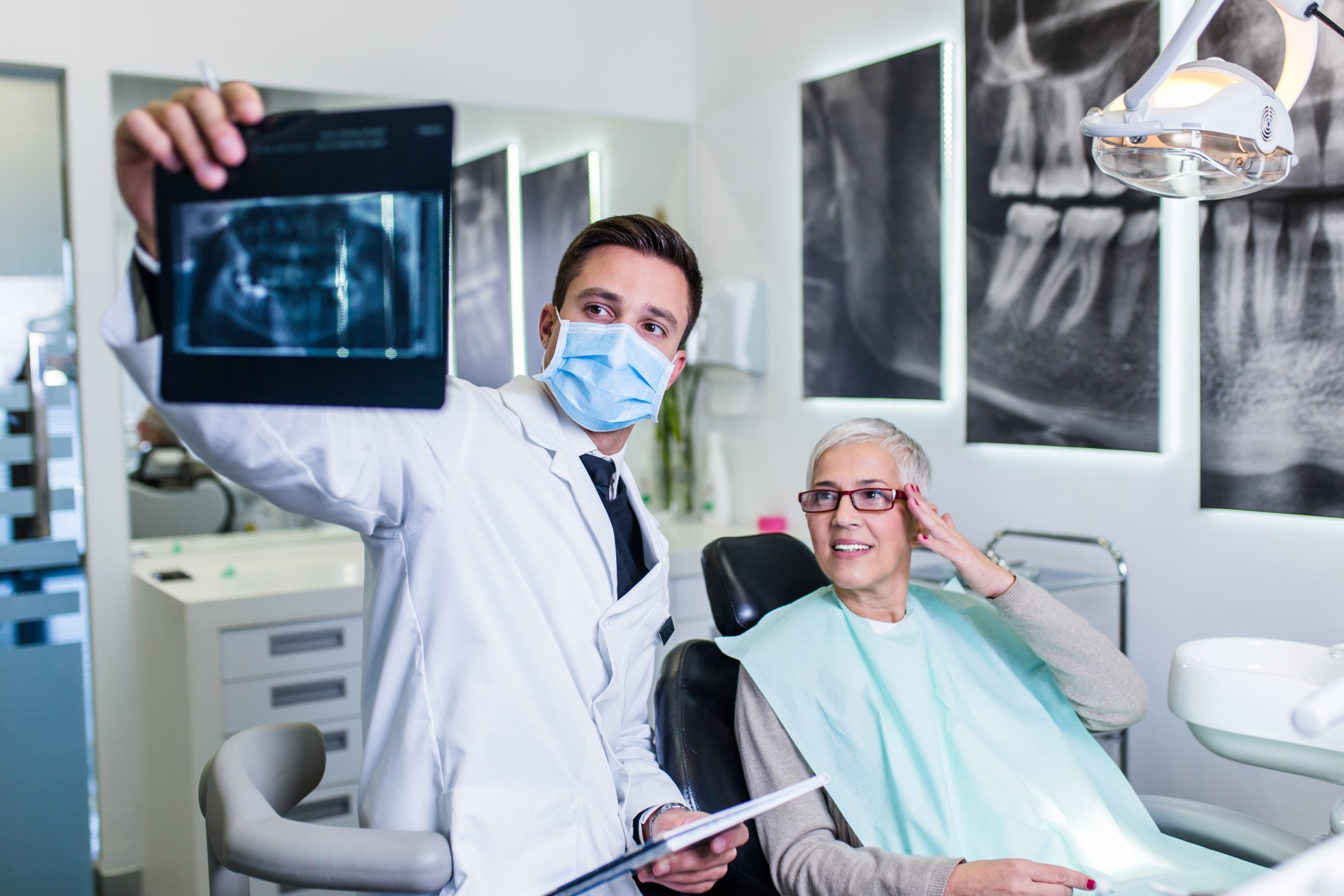 Dentist Showing Xray To Patient