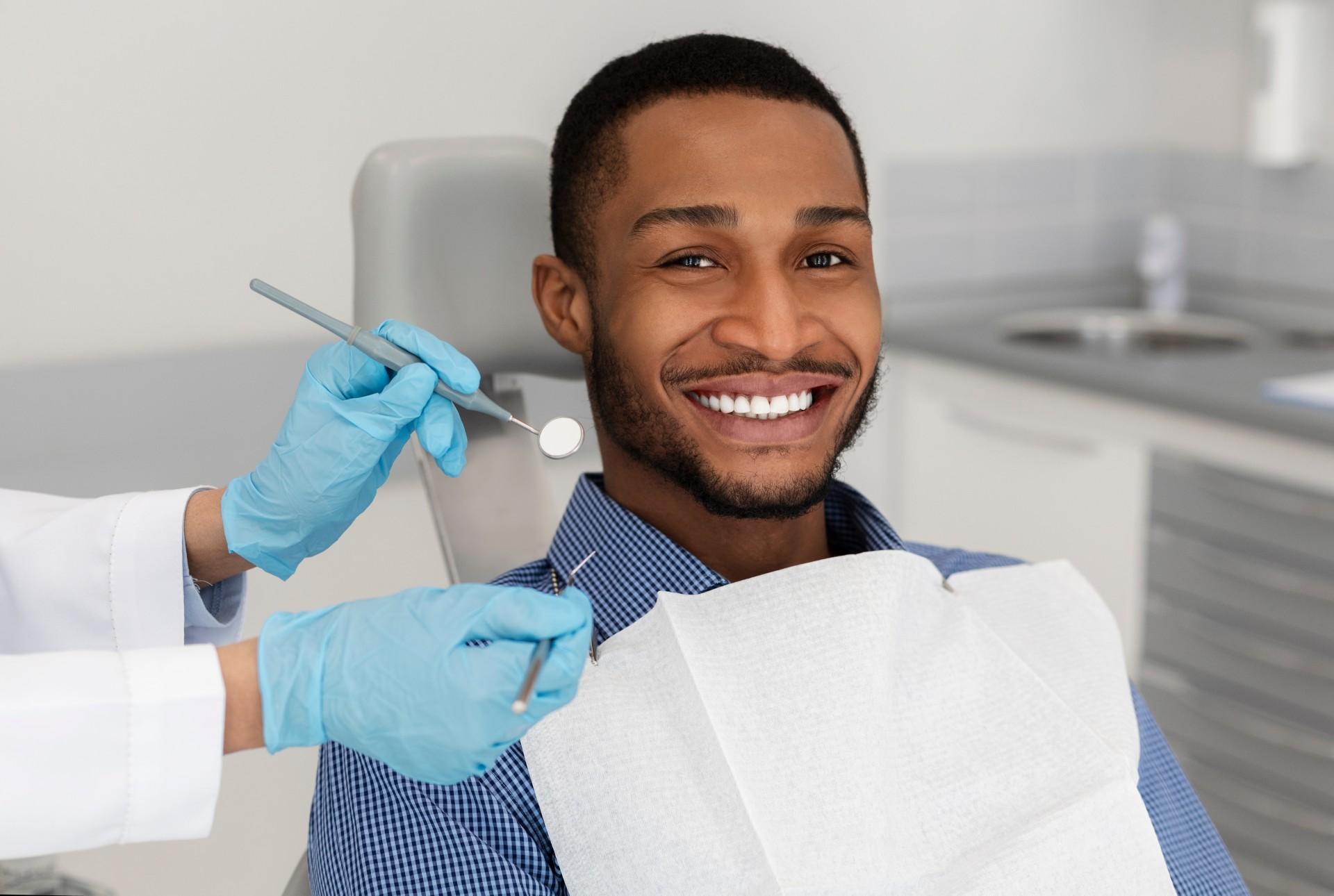Man Recieving Dental Treatment